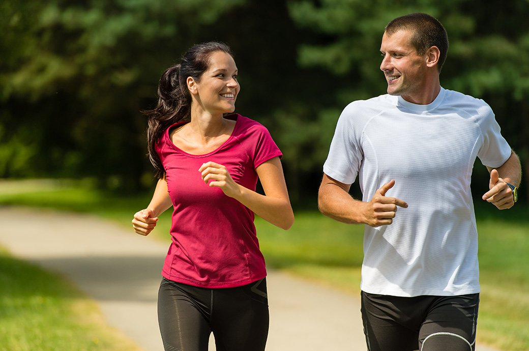 Two adults out on a run outdoors